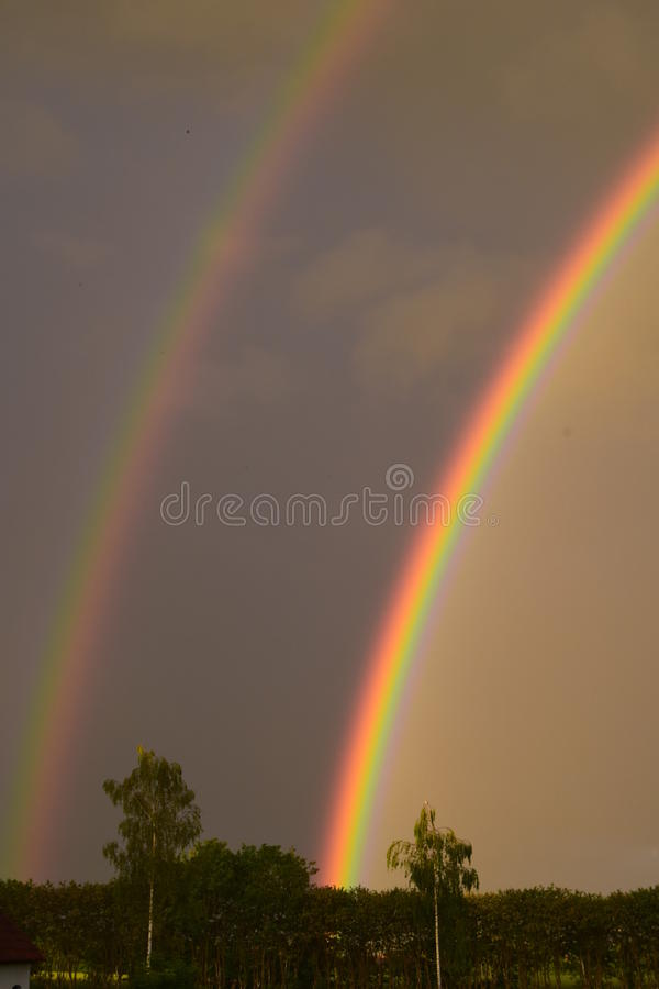 Twin rainbows. These twin rainbows were visible on the sky after a light thunder storm royalty free stock photo