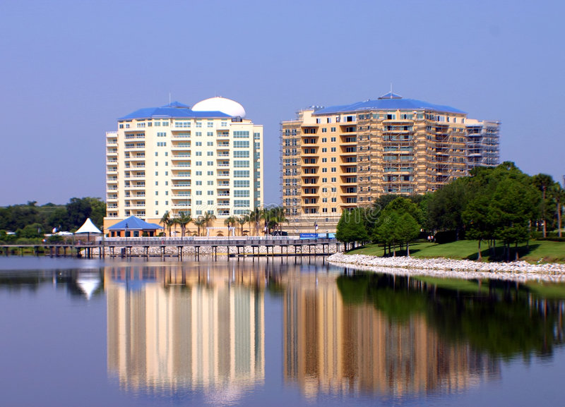 Twin Resort Buildings Reflected In Lake Royalty Free Stock Photos