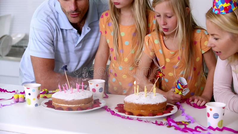 Twin Sisters Blowing Out Candles Stock Footage