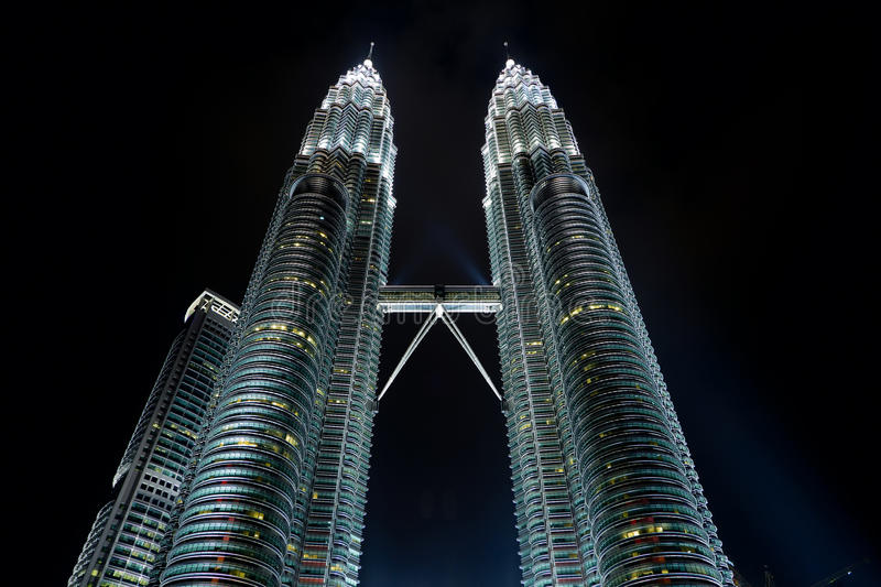 Twin skyscrapers. In the night. Low angle view royalty free stock photography
