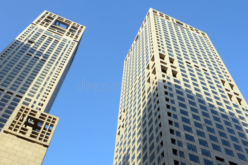 Twin towers against blue sky royalty free stock images