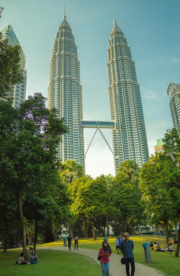 The twin towers and green park in Kuala Lumpur stock images