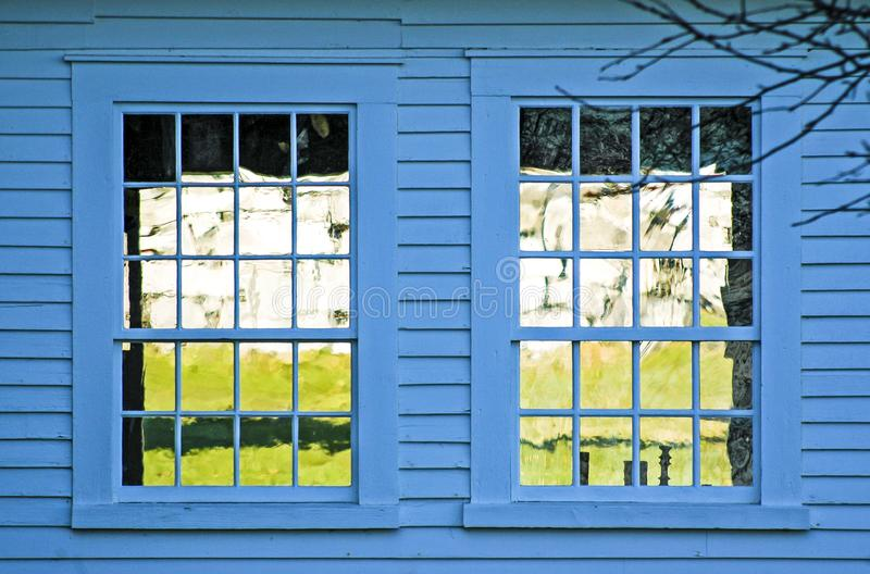 Twin windows on blue building royalty free stock photography