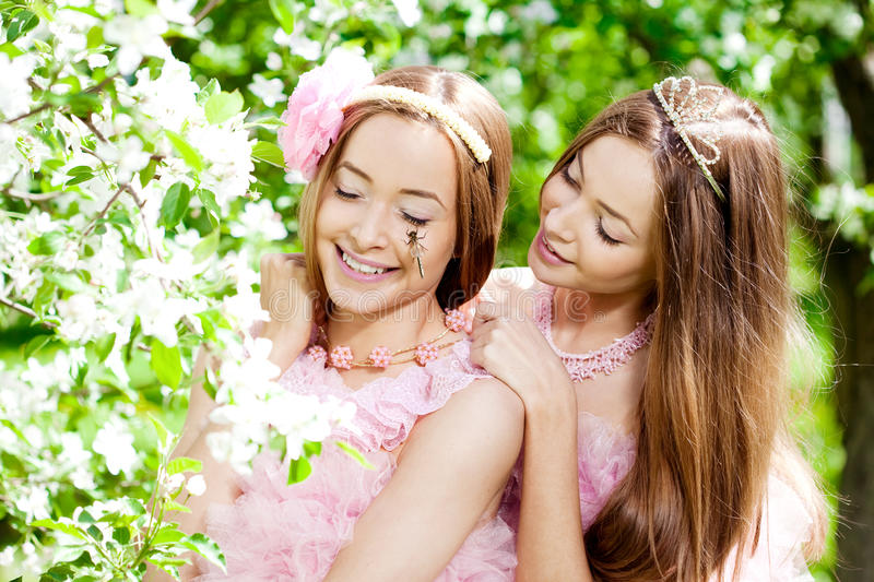 Download Twin Women With A Dragonfly Stock Photo - Image: 25089192