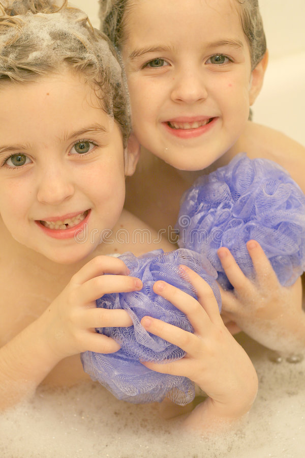 Twins in the bath vertical royalty free stock photo