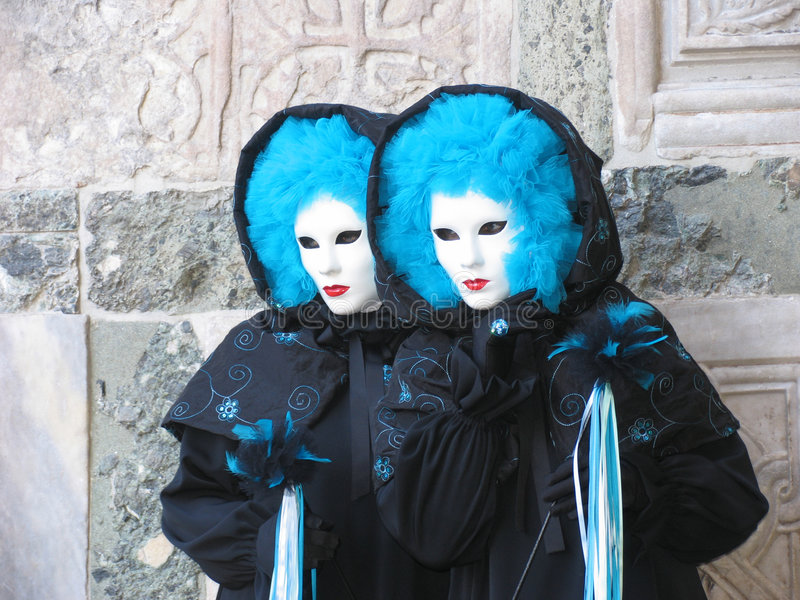 Twins in Carnival costumes & masks, Italy, Venice royalty free stock photos