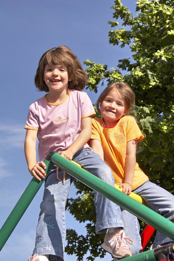 Twins on climbing pole 05 royalty free stock photo