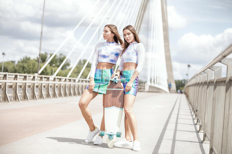 Twins female models posing outdoor. stock photos