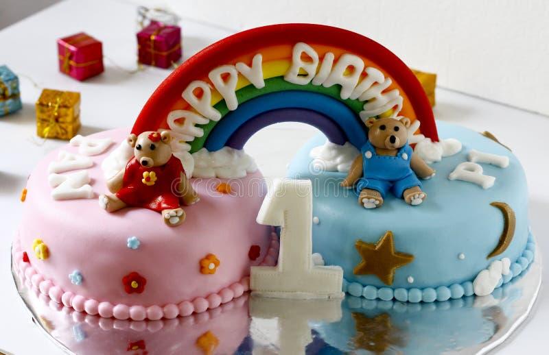 Twins Fondant Cake. With rainbow decoration royalty free stock photo
