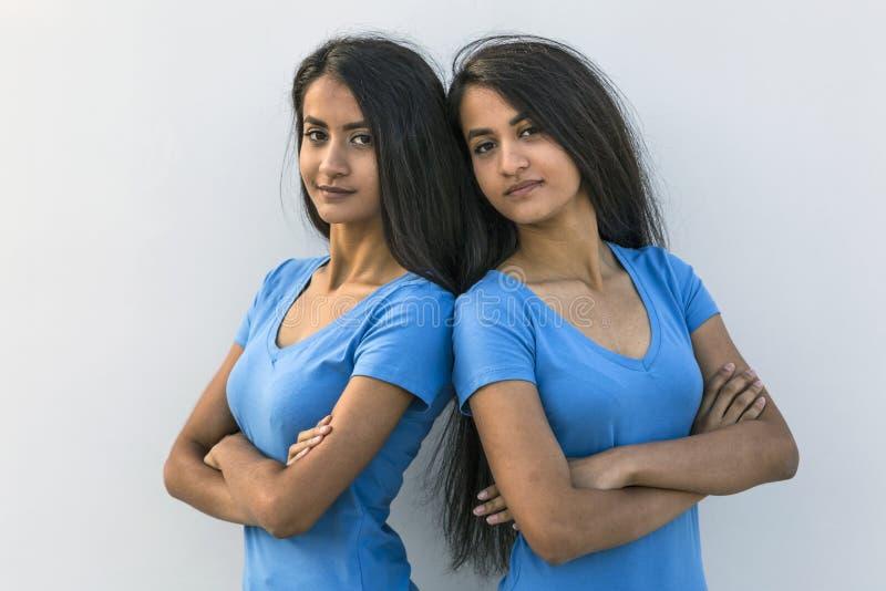 Twins pair backs to backs royalty free stock photos
