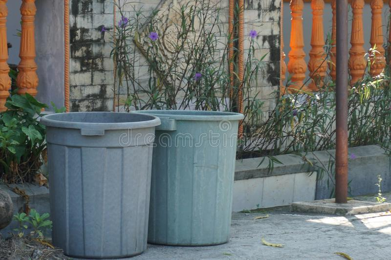 Twins of Plastic Grey Dustbin outside the gate_1 stock image