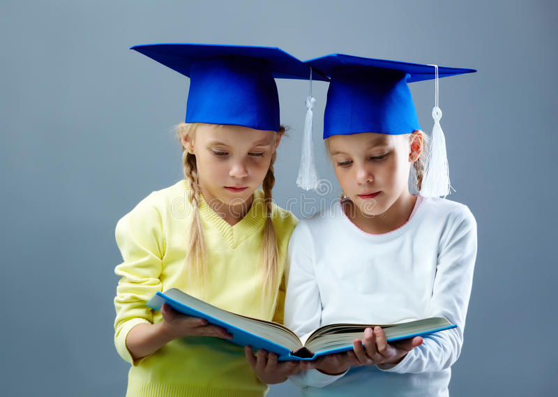 Download Twins reading stock photo. Image of back, graduation - 23291190