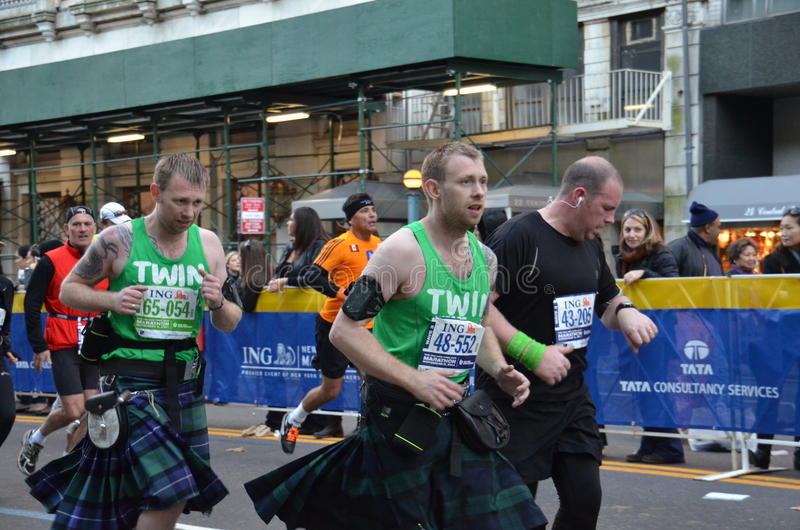 Twins running the Marathon royalty free stock image