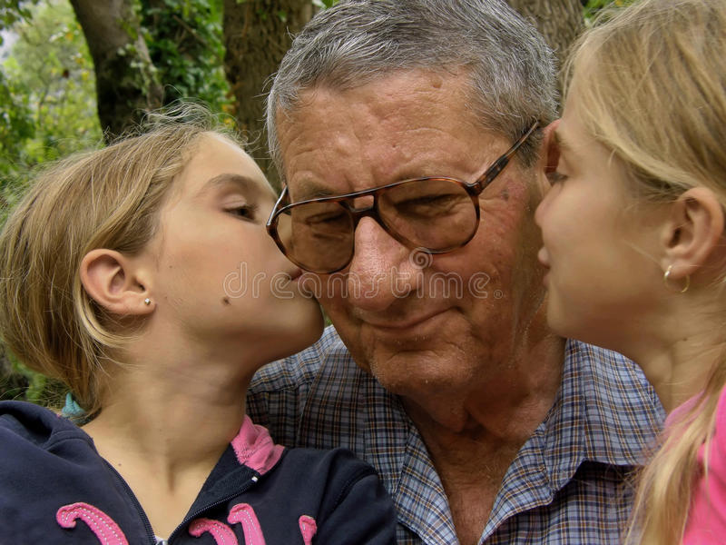 Twins, sisters kiss to grandfather