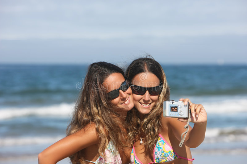 Twins taking a photo royalty free stock image