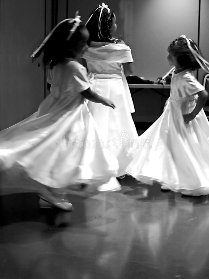 Twirling Flower Girls. Long exsposure ~motion blur~ back and white image of three dancing flower-girls (wedding stock images