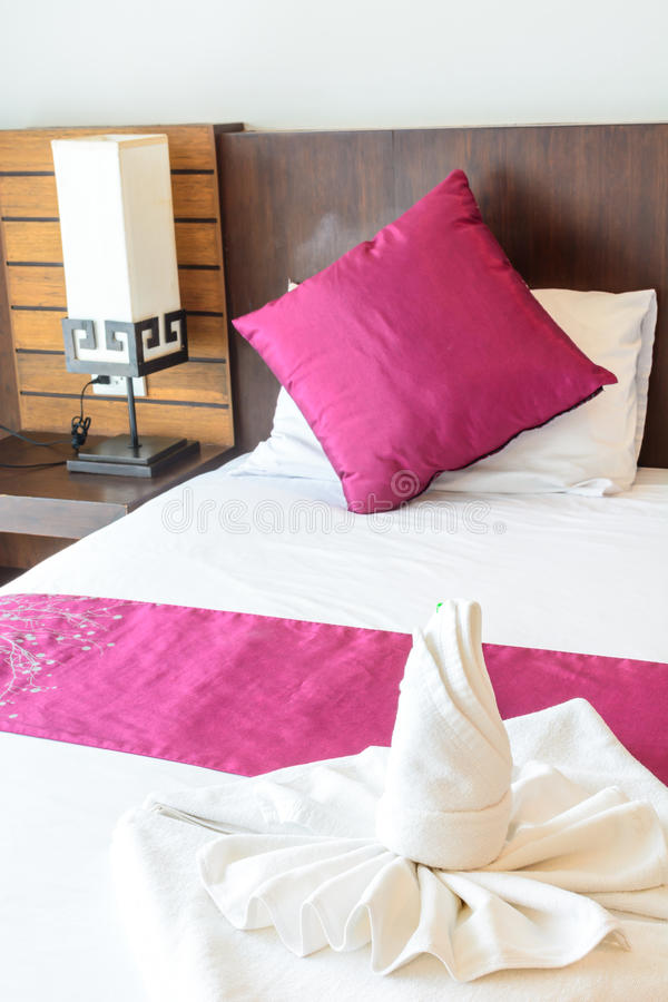 Twist Towel On Bed Stock Photo