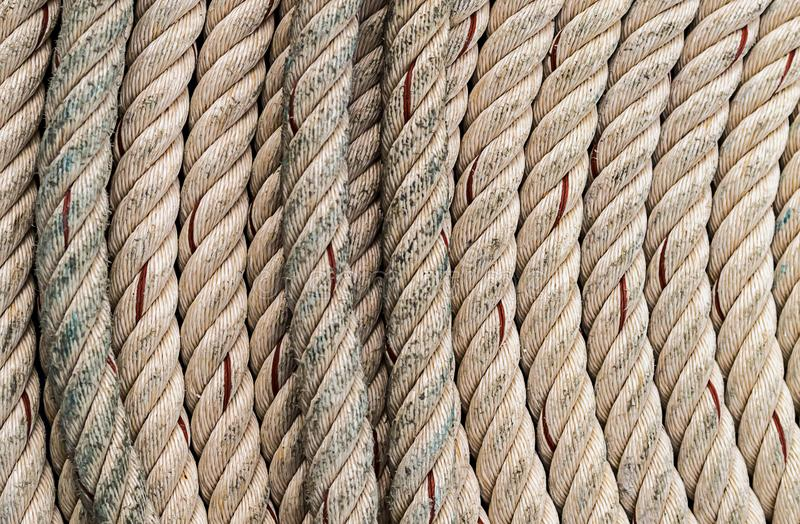 Twisted beige rope natural fiber background marine vertical lines. Of a semicircle stock photography