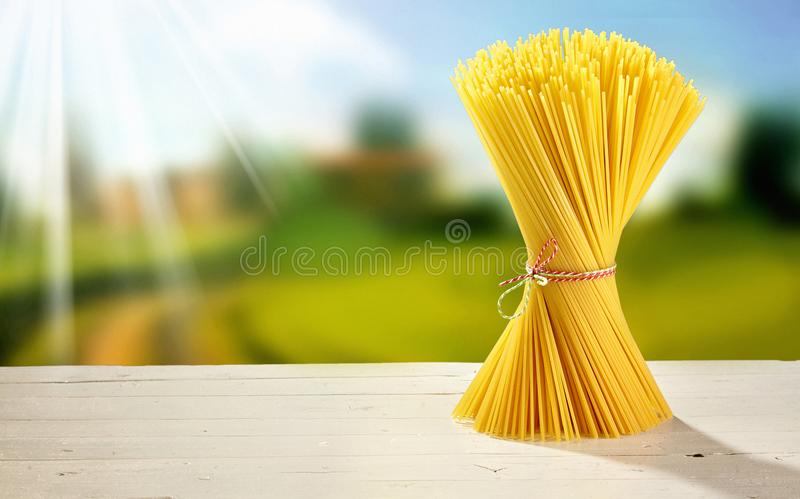 Twisted bundle of spaghetti on a garden table stock photography