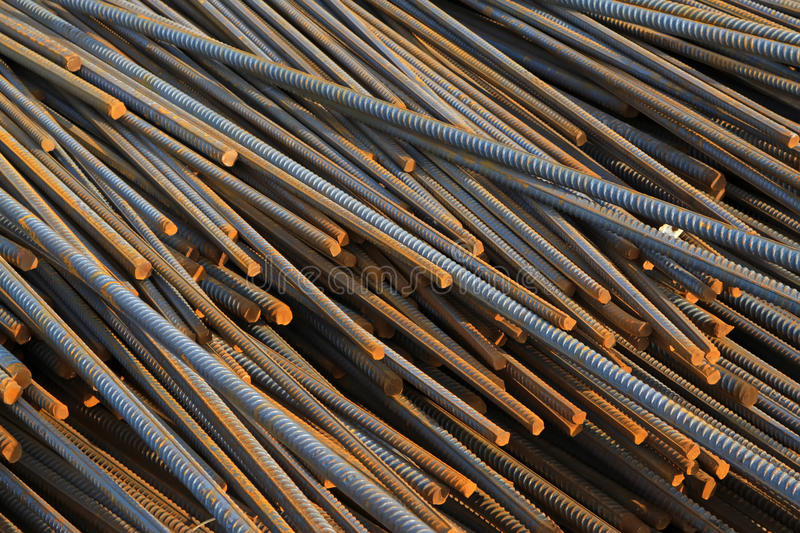 Twisted steel construction materials. In a construction site royalty free stock image
