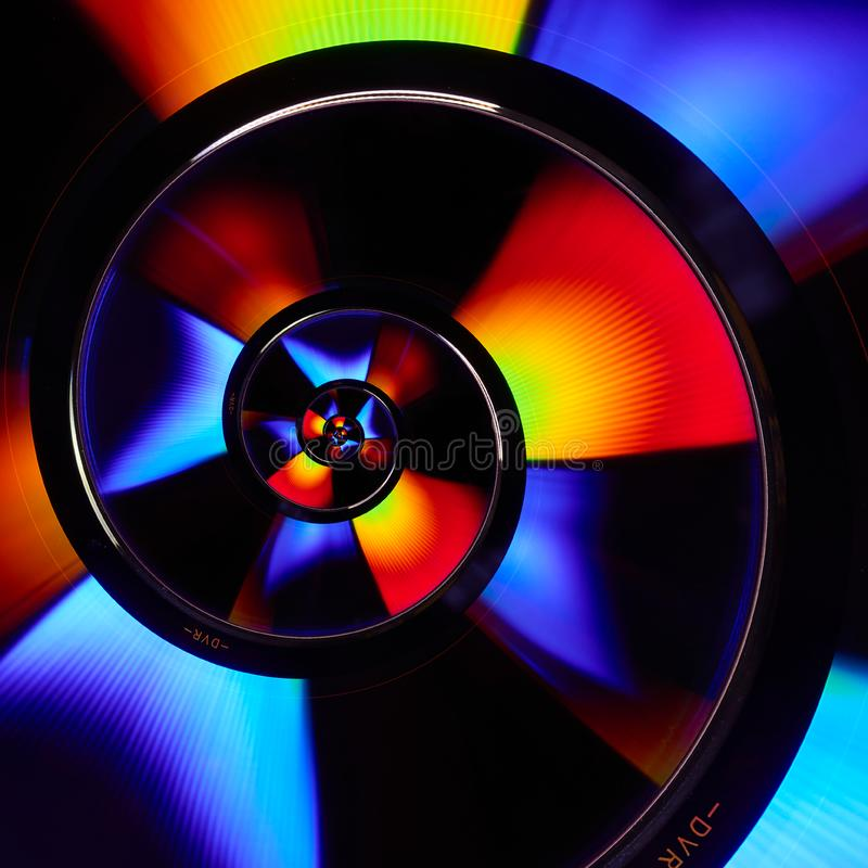 Twisted verzerrte Diskettenzusammenfassungsspiralenhintergrund Fractalmuster der CD DVD Fractal Diskette der Blu-ray Disc-Oberflä stockfotos