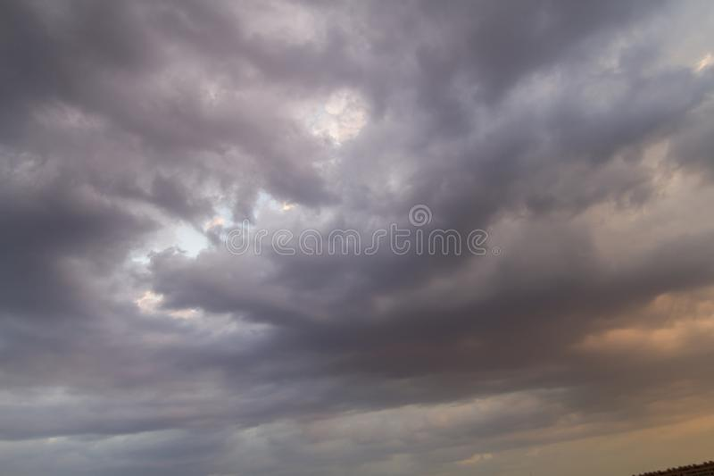 Twister, Autumn sky with dark colors and very gray clouds and ra royalty free stock photo