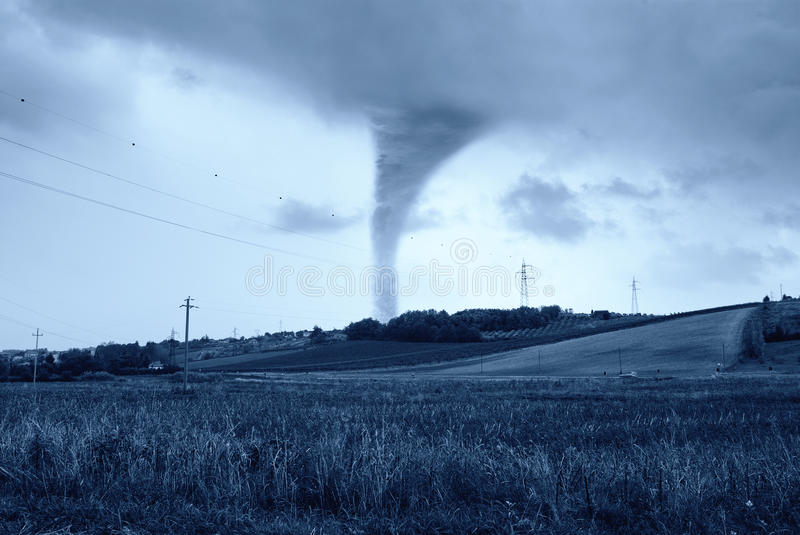 Twister behind the hill stock image