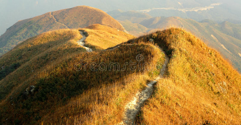 Twisting mountain path. Under sun light royalty free stock images