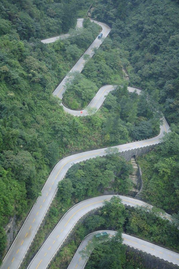 Twisting and Winding Road. The snake like twisting and winding road going up and down Tianmenshan (Mount Tianmen) in Zhangjiajie Hunan province China royalty free stock photos