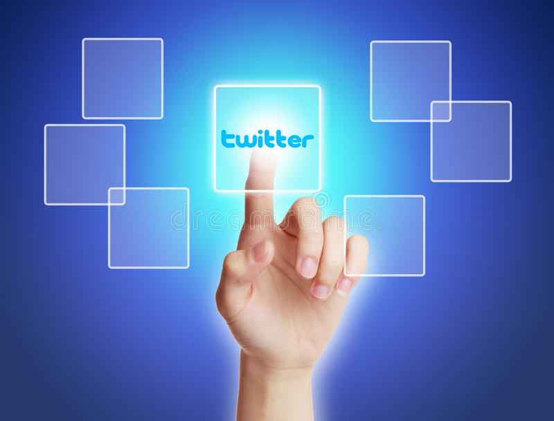 Twitter Concept. Hand press twitter virtual button with blue background