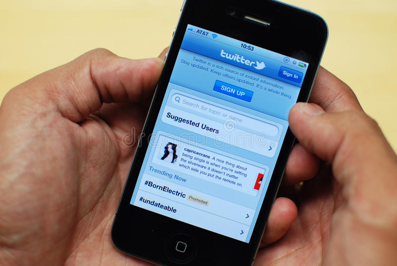 Twitter on iPhone 4 stock photography