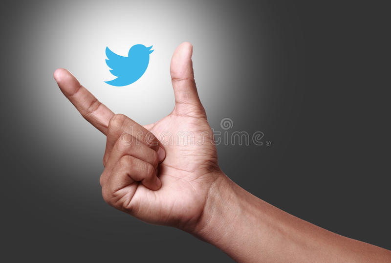Twitter. Johor, Malaysia - May 11, 2014: Hand showing twitter icon. Twitter is a famous social networking website, May 11, 2014 in Johor, Malaysia