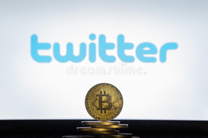Twitter logo on a computer screen with a stack of Bitcoin cryptocurency coins. royalty free stock photos