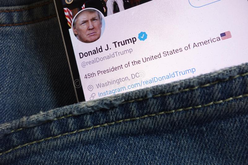 Twitter page for Donald Trump displayed on smartphone hidden in jeans pocket royalty free stock photo
