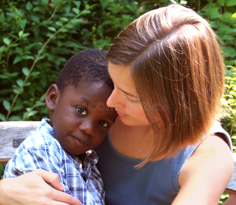 Two. Young Caucasian woman with African American child