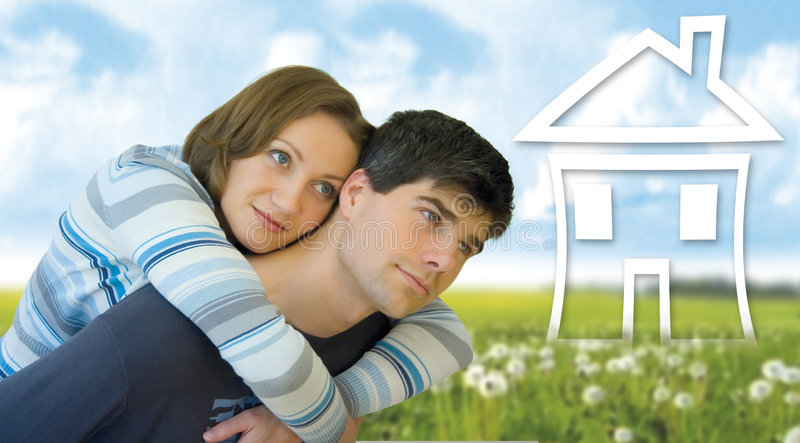 We two 5. Young couple having fun in a meadow. They are thinking about having a house
