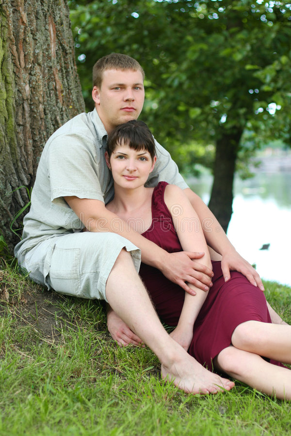 Two. Happy young couple relaxing near the river royalty free stock photo
