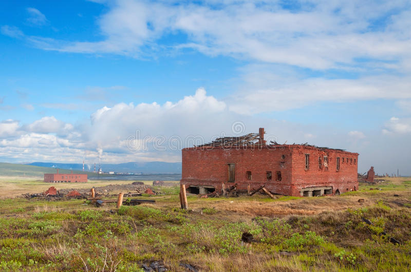 The two abandoned brick building in the tundra stock photo