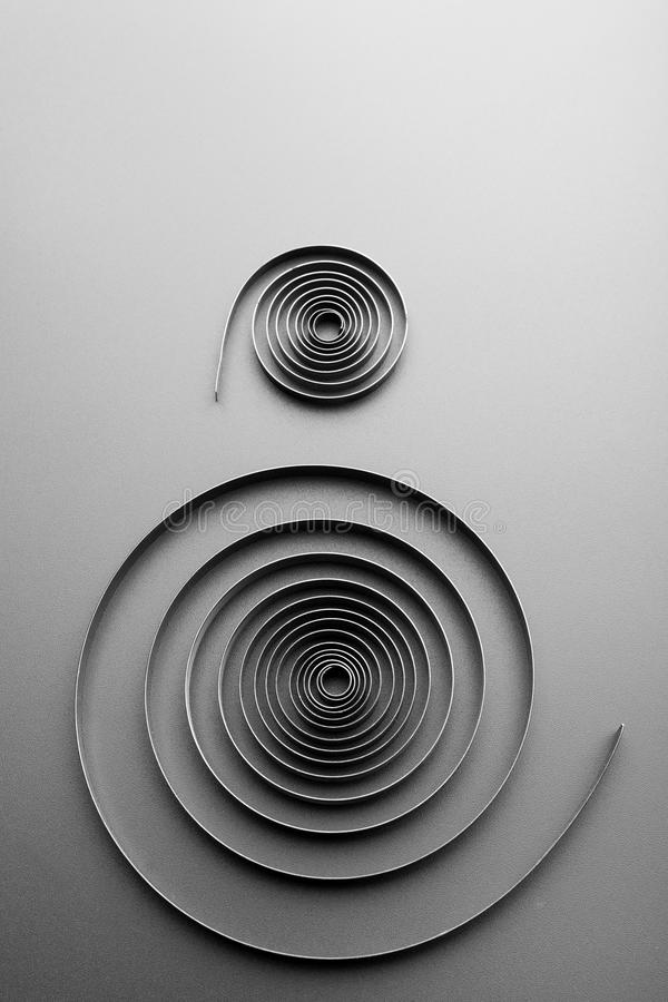 Two abstract metallic spirals royalty free illustration