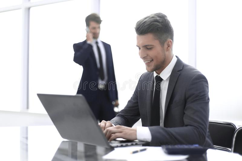 Two accountants solve important issues. Two accountants solve important questions. One uses a laptop, the second is talking on the phone royalty free stock images