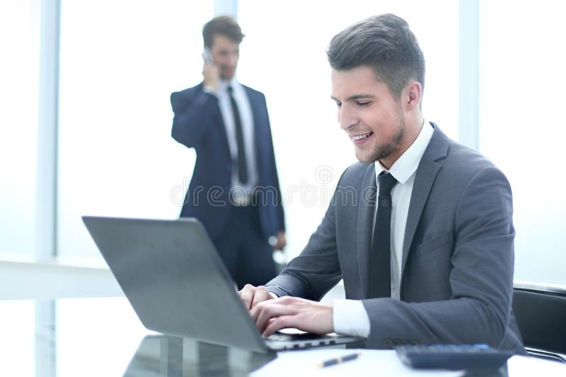 Two accountants solve important issues. Two accountants solve important questions. One uses a laptop, the second is talking on the phone stock photos