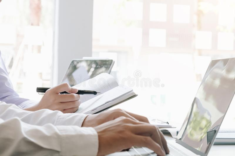 Two accounting Concepts, Male use notebook, pen and computer laptop to working financial and budget, inspector accountant concept royalty free stock photos