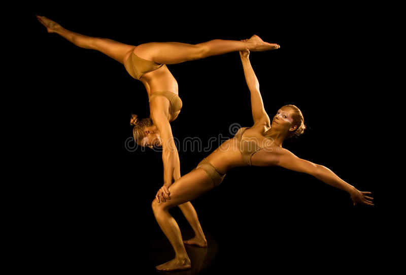Two acrobatic girl. Making acrobatic tricks royalty free stock images