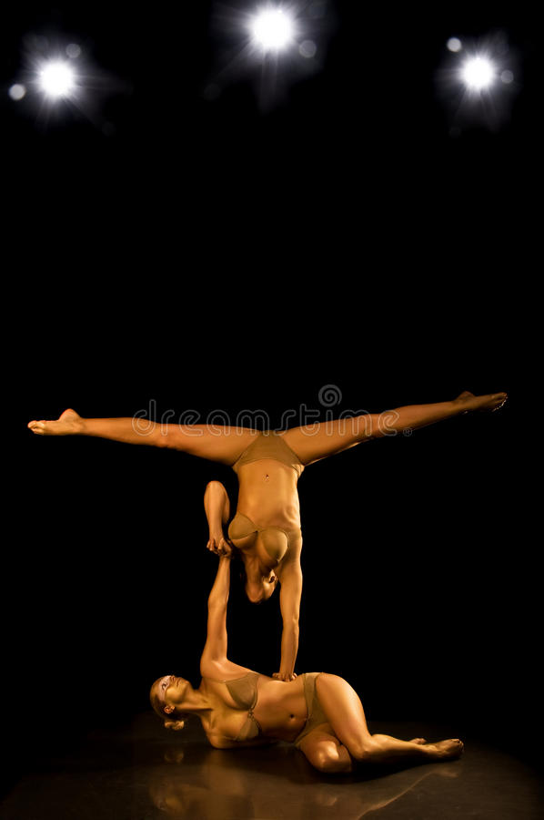 Two acrobatic girl. Making acrobatic tricks stock images