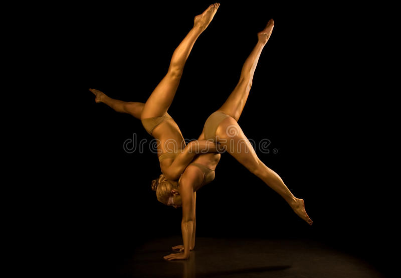 Two acrobatic girl. Making acrobatic tricks stock photography
