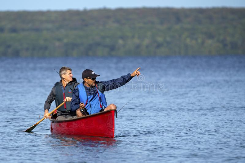 Looking for the spot to catch a fish on Georgian Bay, Ontario. Two active fishermen on Georgian Bay near Christian Island are hoping to find the spot to catch royalty free stock images