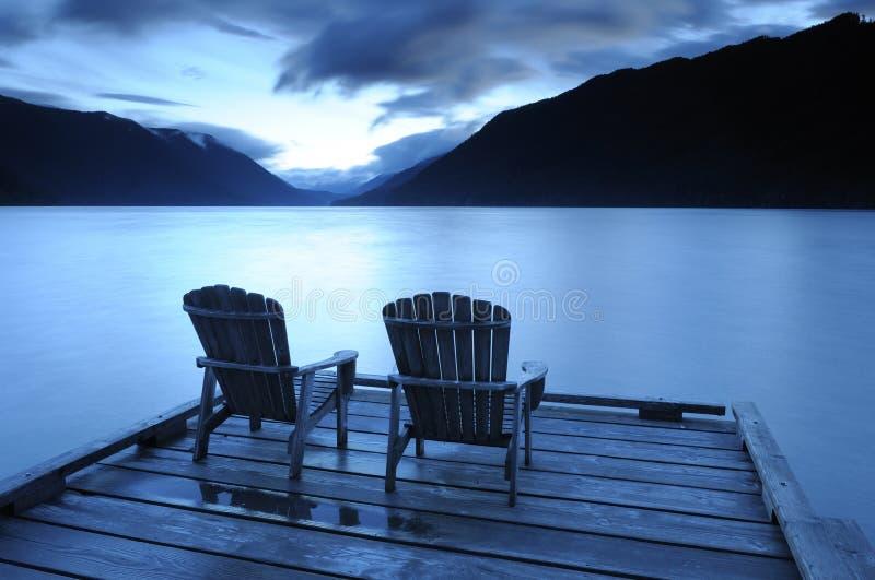 Two Adirondack chairs stock photography