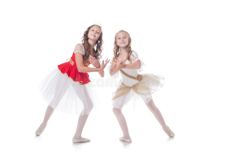 Two adorable ballet dancers, isolated on white royalty free stock photo