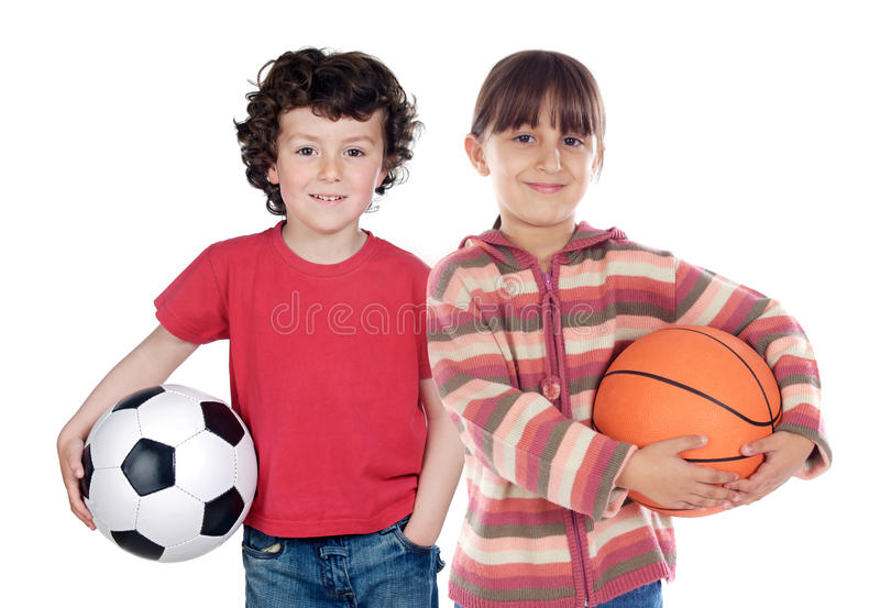 Two adorable children with balls stock images