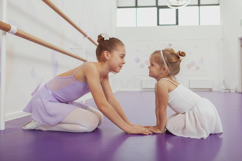 Charming two young ballerinas practicing at ballet class royalty free stock photography